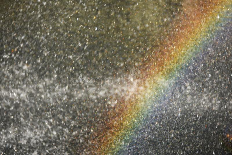 Rainbow in sparkling drops of water in the sunlight. Abstract photo, screen saver royalty free stock image