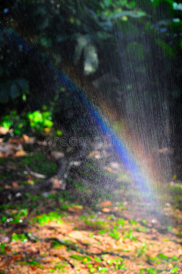 Download Rainbow Through Spray Of Water Stock Image - Image: 7655749