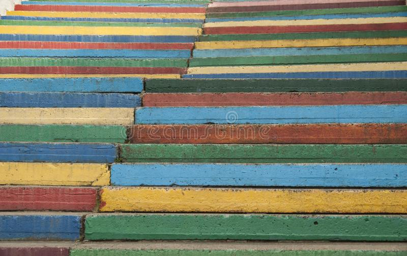 Rainbow steps are going up in the parl royalty free stock image