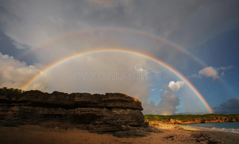 Rainbow. In summer days, after rain and sunshine comes again, so we can see beautiful rainbow in the sky stock photo