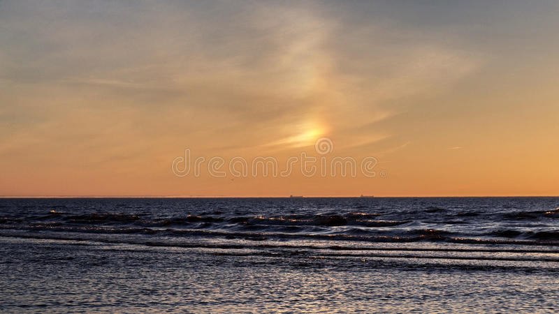Rainbow Sunset orange sky and sea royalty free stock images