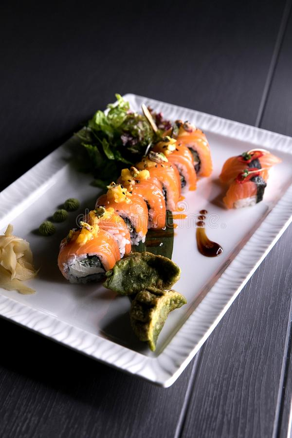Rainbow Sushi Roll.Sushi menu. Japanese food. Top view of assorted sushi stock image