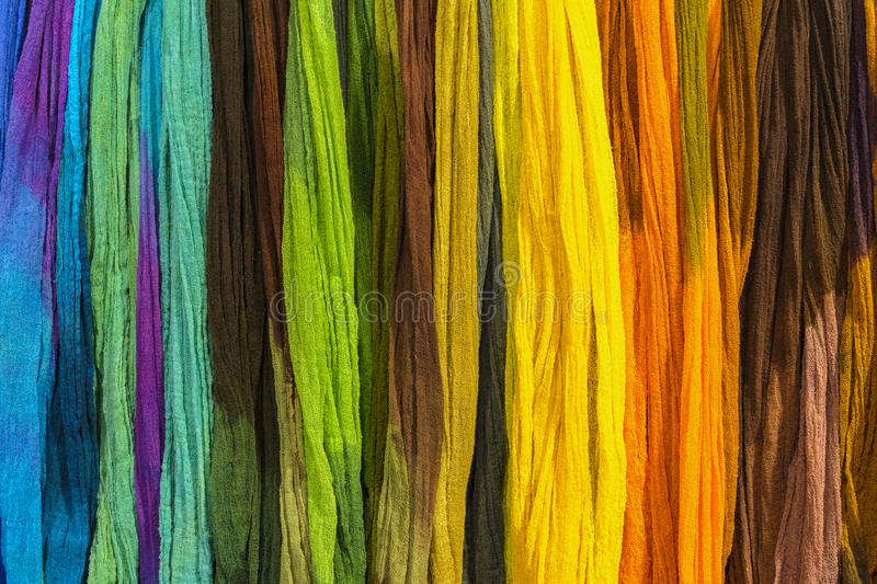 Rainbow textiles background. An rainbow colored textiles, exposed for sale in bazaar stock photography