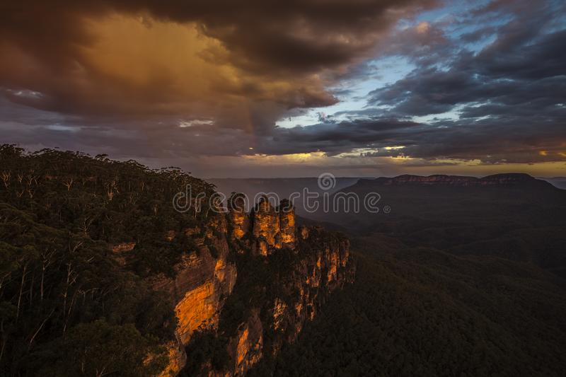Rainbow at Three Sisters, Blue Mountains National Park. Scenery at sunset. A rainbow is seen in the sky stock photos