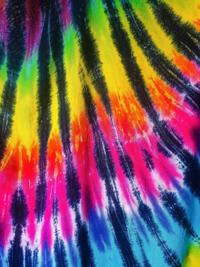 Rainbow Tie Dye. A brilliantly lit rainbow tie dye in a rainbow pattern of colors with dark lines on cotton cloth royalty free stock photography
