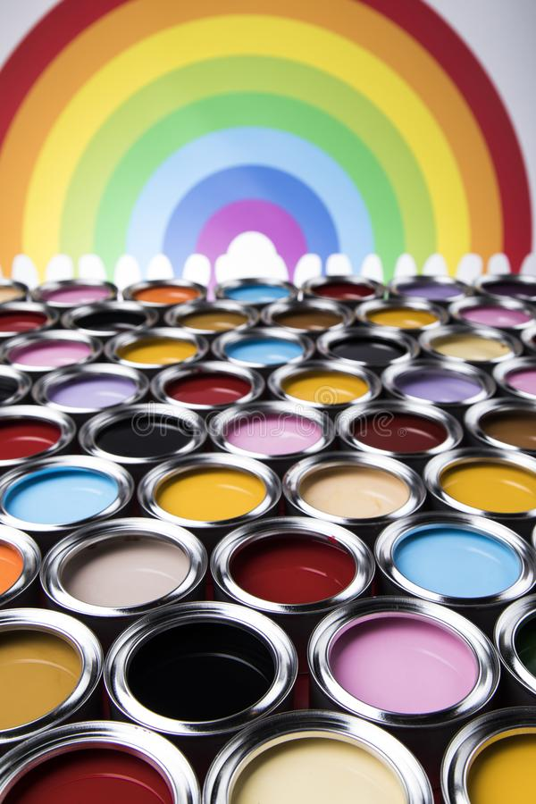 Rainbow, tin metal cans with color paint royalty free stock image