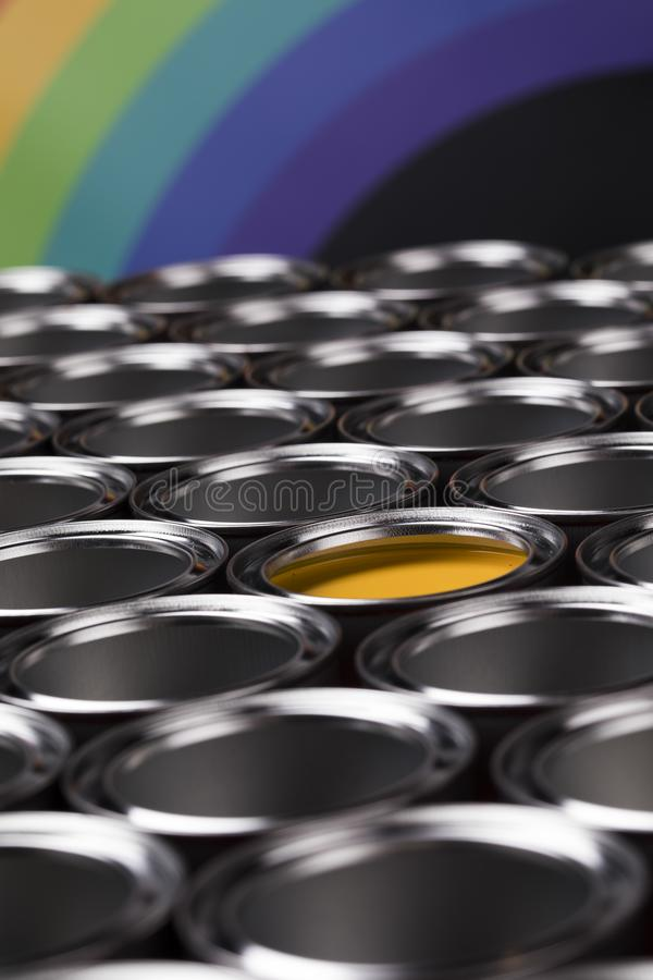 Rainbow, tin metal cans with color paint royalty free stock photo
