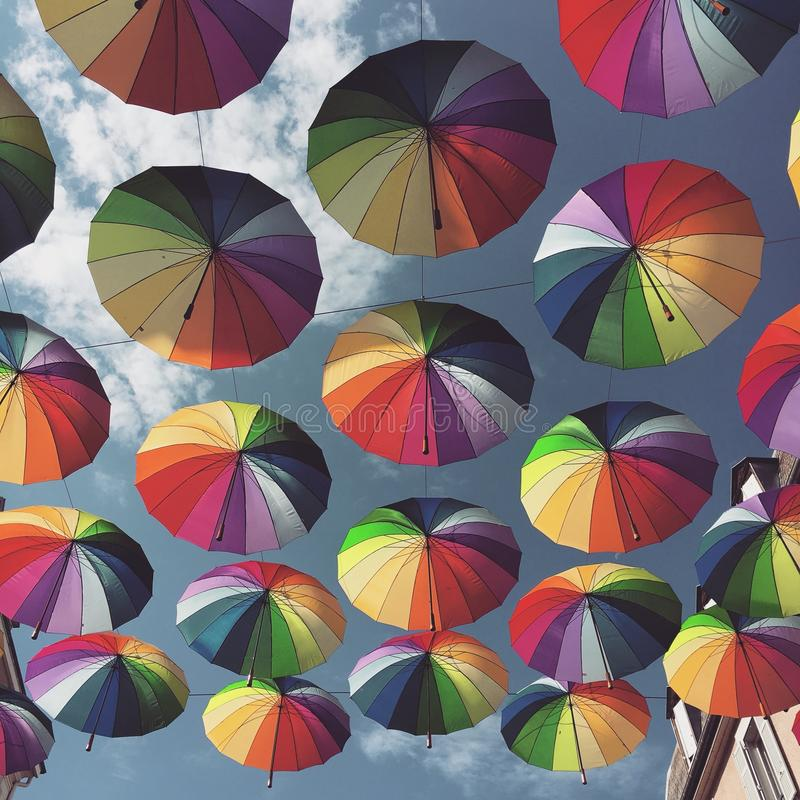 Rainbow umbrellas royalty free stock photo
