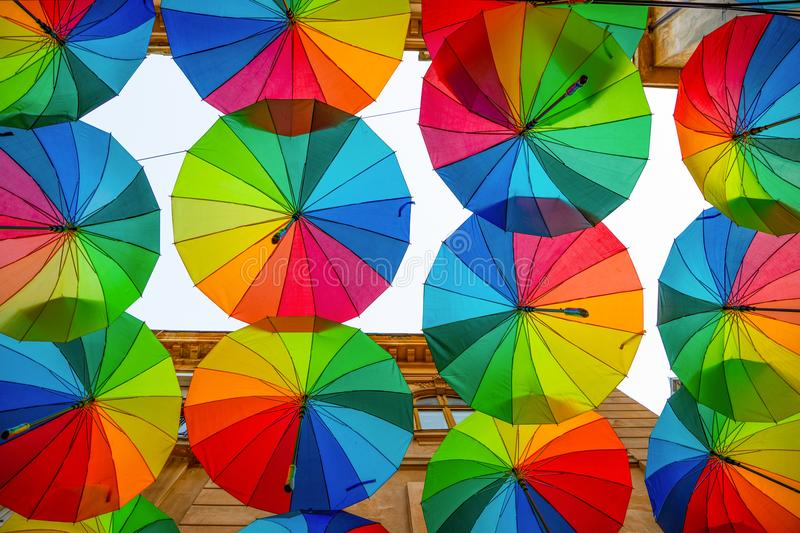 Rainbow umbrellas roof street in Victory Passage , Bucharest royalty free stock photography