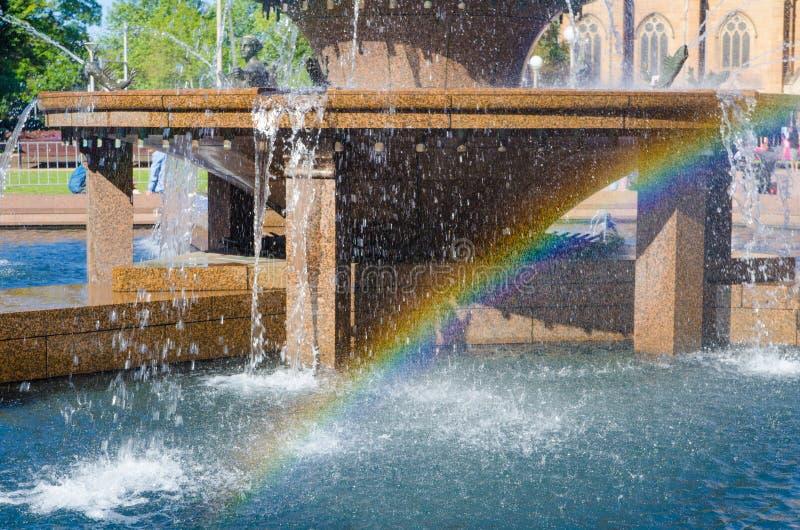 Rainbow under the fountain waterfall at a public park, Sydney, Australia. royalty free stock photography