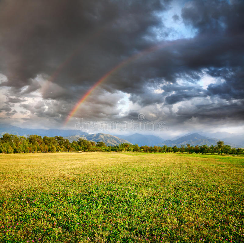 Download Rainbow under Grass field stock photo. Image of idyll - 21227894