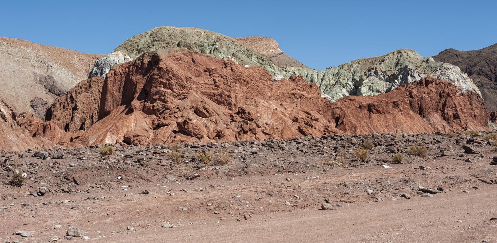 Rainbow Valley Valle Arcoiris, in the Atacama Desert in Chile. The mineral rich rocks of the Domeyko mountains give the valley t. He varied colors from red to stock images