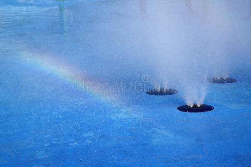 Rainbow and water fountain background. Beautiful rainbow and water fountain background stock photos
