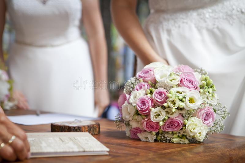 Two brides - lesbian wedding with bouquet stock photography