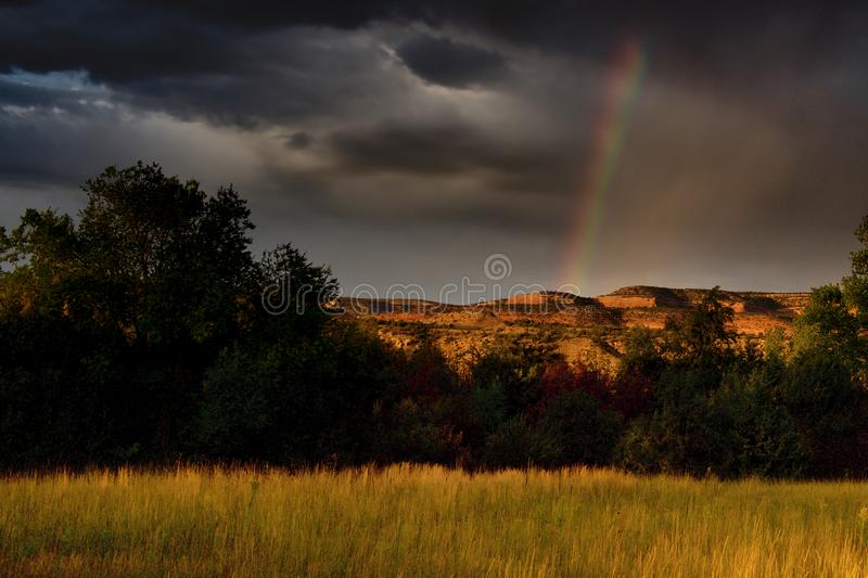 A Rainbow in the Western United States. Colorado rainbow.  Horsethief Canyon SWA is managed for the primary purpose of replacing wildlife habitat.   This area is stock image