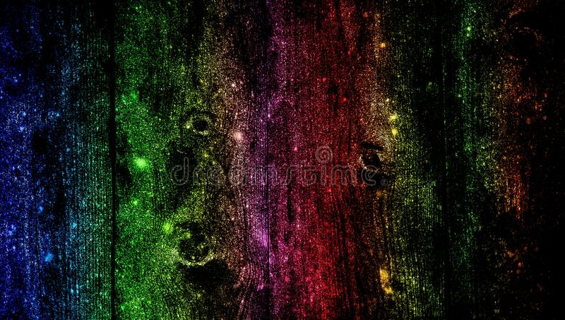 Rainbow wood shaded glitter textured background. wallpaper. royalty free stock images