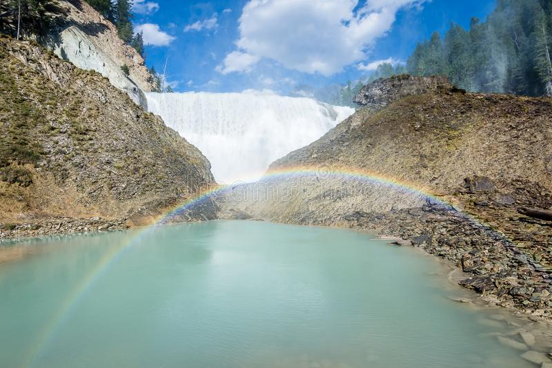 Rainbows through the mist at Wapta Falls royalty free stock photography
