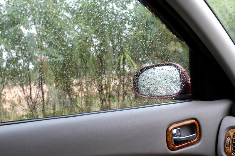 Water Raindrop Fresh on windshield,Feeling relax or lonely in a car, Cleaning Glass Automotive royalty free stock images
