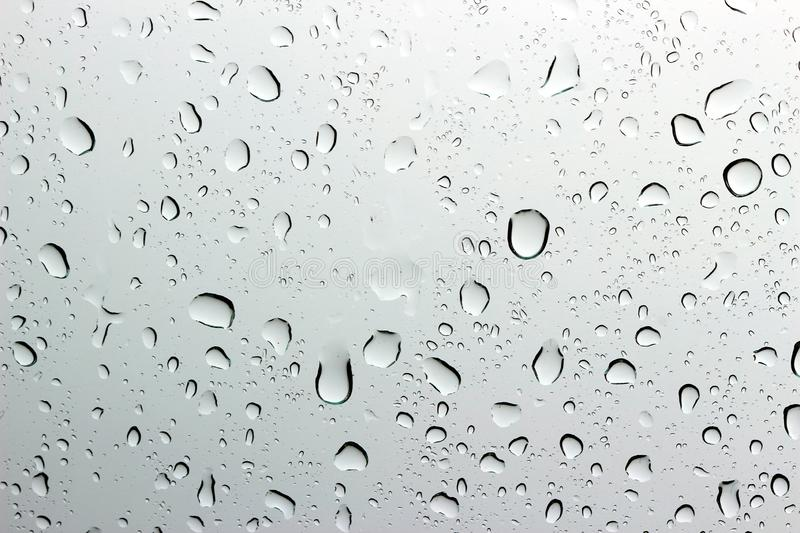 Raindrop on the glass 2. A small raindrop rests on the glass after rain stock image