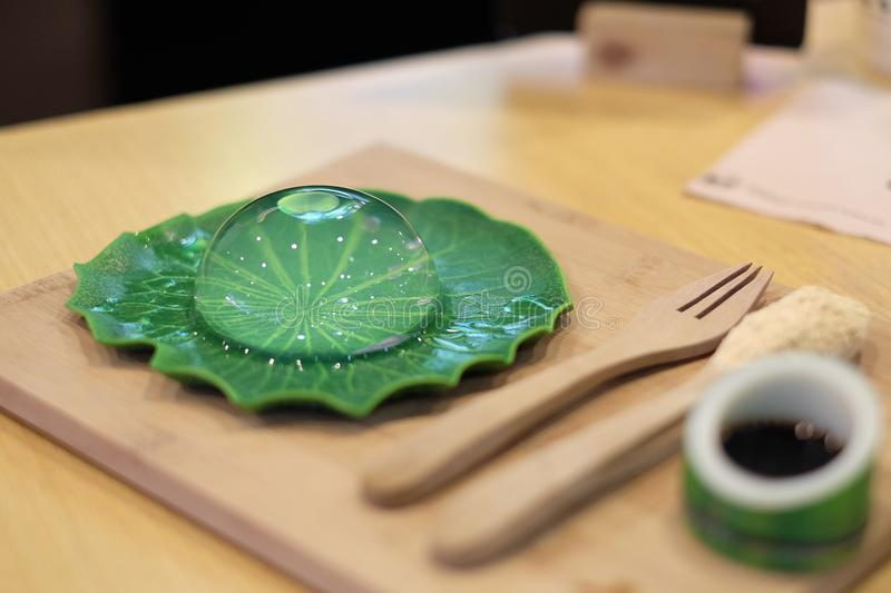 Raindrop mochi with black sugar syrup and roasted soybean powder. stock photography