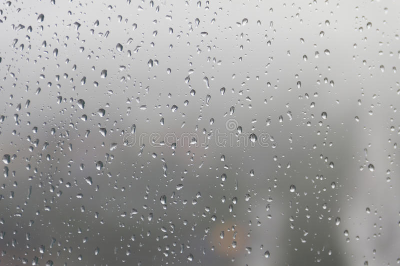 Raindrop, water drops on a glass surface of window.  royalty free stock photography