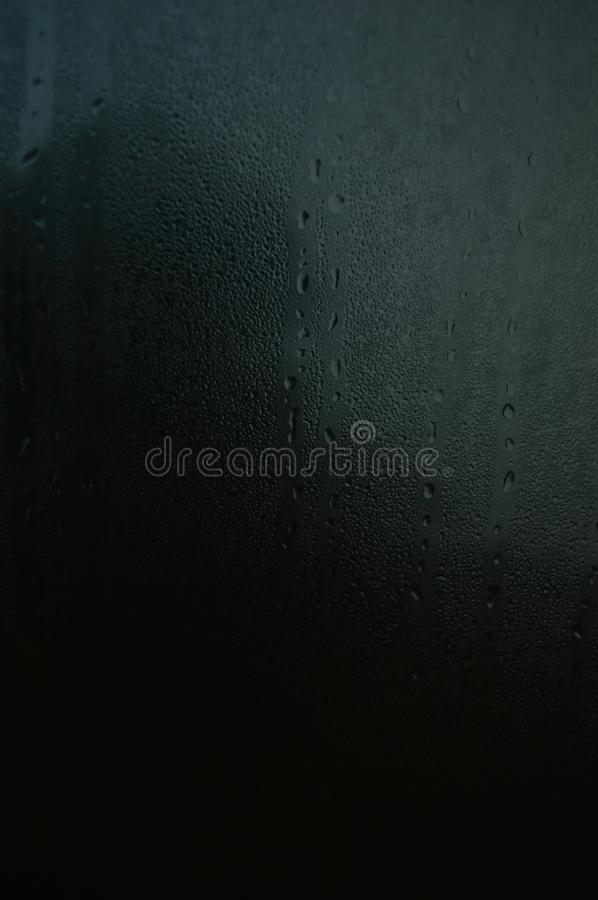 Raindrops on a car window in the dawn smudges blurred stock photography