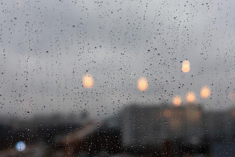 Raindrops downpour on the window, bad weather. Background backdrop, large drops of water on the glass stock photography