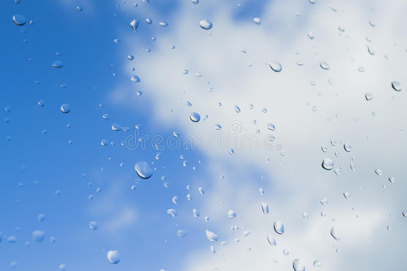Raindrops falling out of the sky. stock images