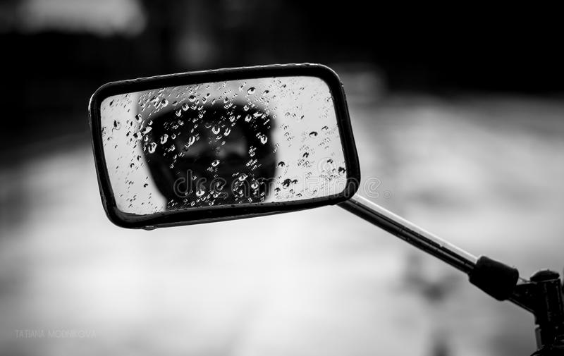 Raindrops on the motorcycle mirror. royalty free stock image