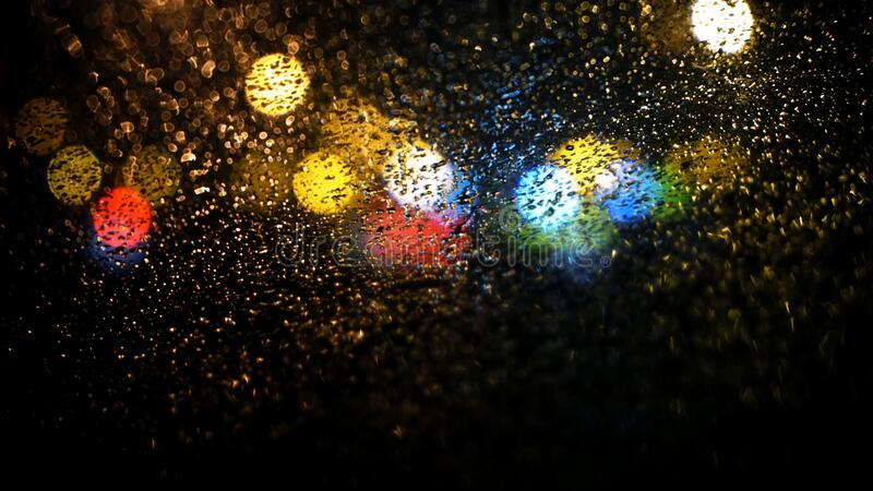 Raindrops on Road Seen Through Car Window stock photography