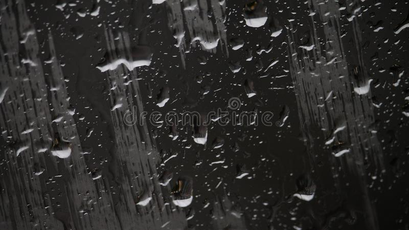 Raindrops and smears on glass, closeup royalty free stock photo
