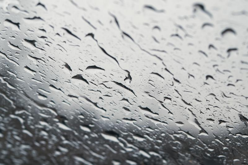 Raindrops on the window close up. rain drops on the glass macro. water drops falling down on window. rainy day. Wet glass. raindrops trickle down, abstract royalty free stock photography