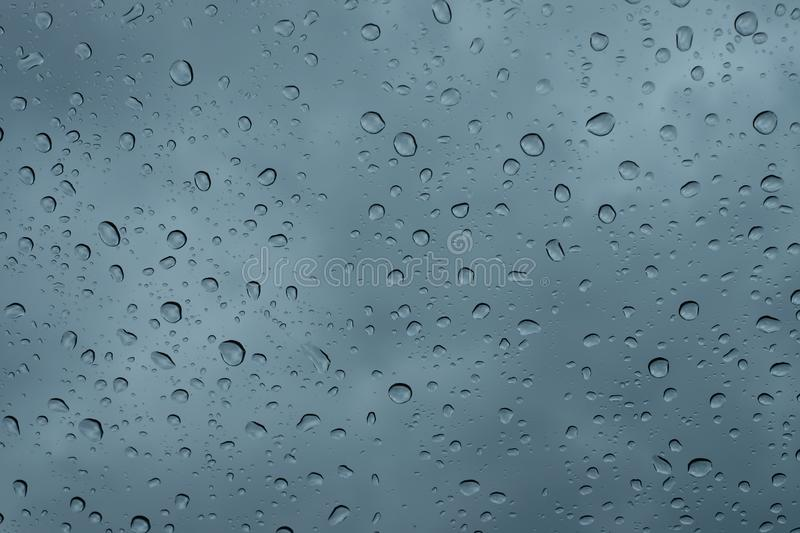 Raindrops on the window close up. rain drops on the glass macro. water drops falling down on window. rainy day. Wet glass. raindrops trickle down, abstract royalty free stock images