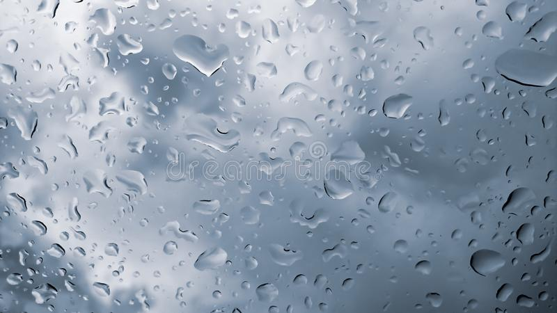Raindrops on the window close up. rain drops on the glass macro. water drops falling down on window. rainy day. Wet glass. raindrops trickle down, abstract stock photos