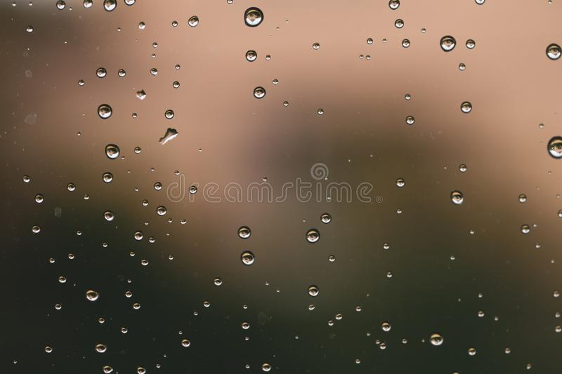 Raindrops on window glass close up. water drops abstract macro background royalty free stock images