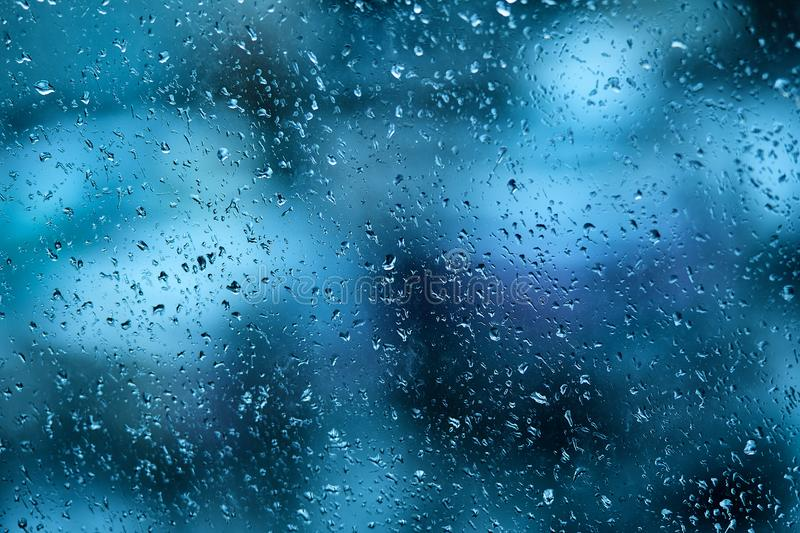 Raindrops on the windshield of the car in the early morning. Transparent glass after rain, cold abstract photo. Texture of glass w royalty free stock images
