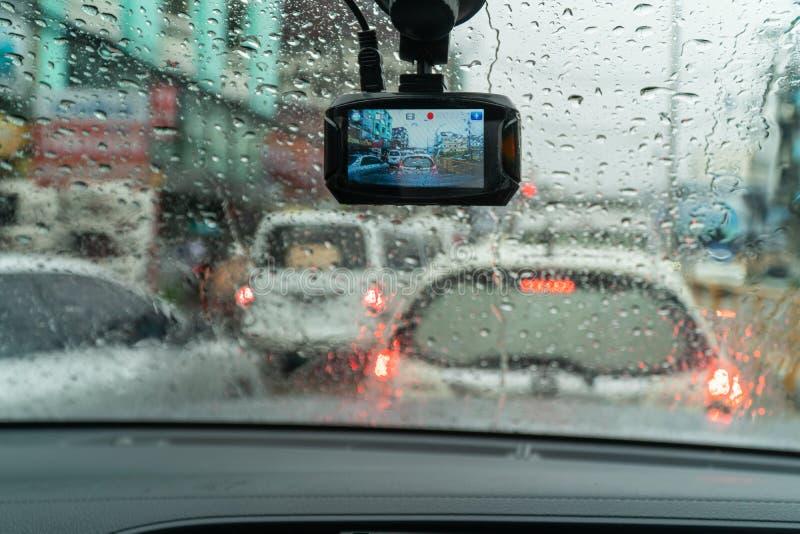 Raindrops on windshield in traffic jam. Raindrops on windshield from inside the car in traffic jam stock photo
