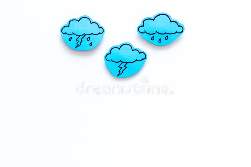 Rainfall forecast concept. Weather icons. Rainy cloud, lightening on white background top view copy space royalty free stock photo