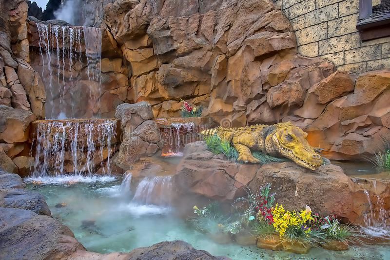 Rainforest Cafe Detail Closeup With Waterfall And Large Gator. At Disney Springs in Florida royalty free stock photos