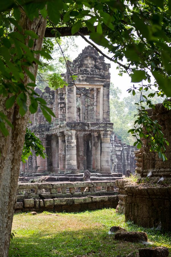 Rainforest landscape with Preah Khan Temple. View through the trees and leaves on the Preah Khan temple in Angkor Wat complex at Siem Reap, Cambodia stock images