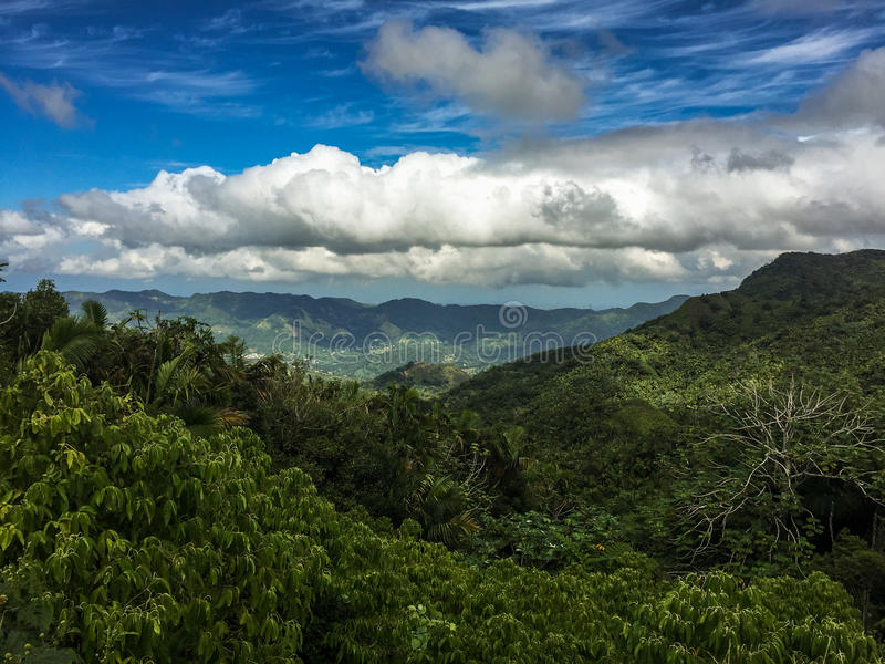 Rainforest and mountains in Puerto Rico with clouds in the sky royalty free stock photography
