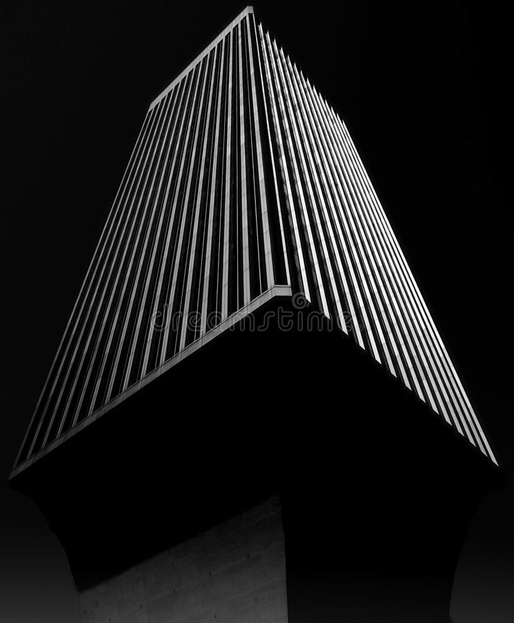 Rainier Tower in Seattle. A black-and-white rendering of Seattle's iconic Rainier Tower, which sits atop a pedestal base that tapers toward the ground, like an stock image