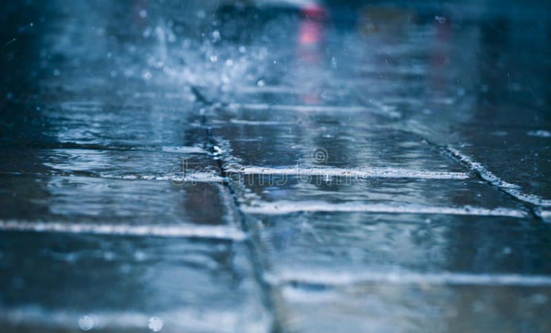 Raining day. Rough texture of wet block pavement steet , raining day royalty free stock photos