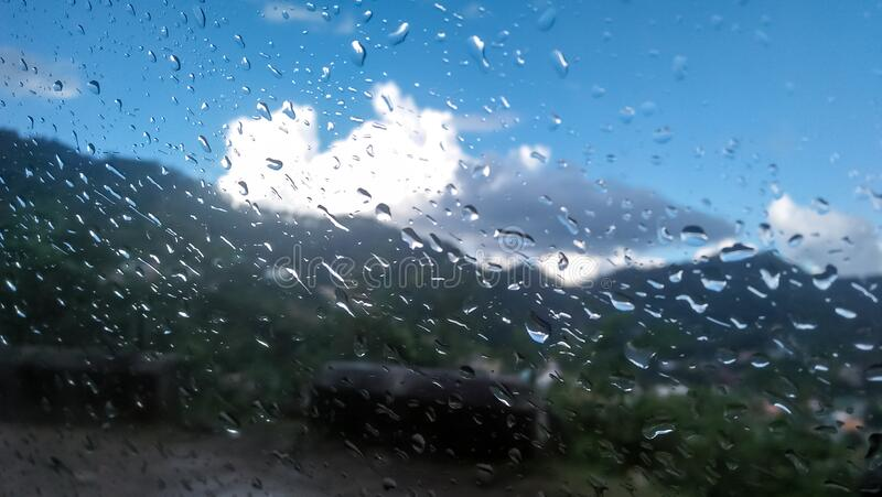 Raining Water Drops On Car Mirror With Mountains And ...