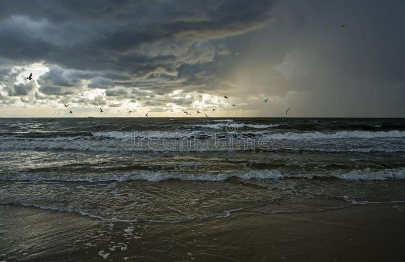 Raining over the Baltic Sea at sunset time. stock image