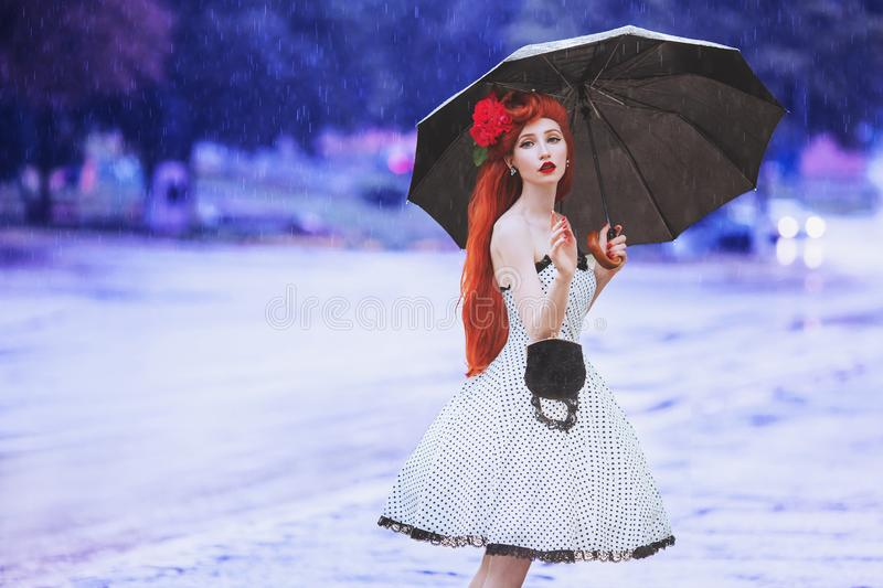 Raining weather. Autumn rain. Sick girl in anxiety in dress hold umbrella. Umbrella protection. Lonely woman with disease was. Caught in rain. Sick girl in royalty free stock photography