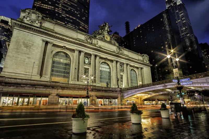 Rainning night street scene at Grand Central Terminal in midtown Manhattan. New York City - USA - Jun 20 2019: Rainning night street scene at Grand Central stock photos