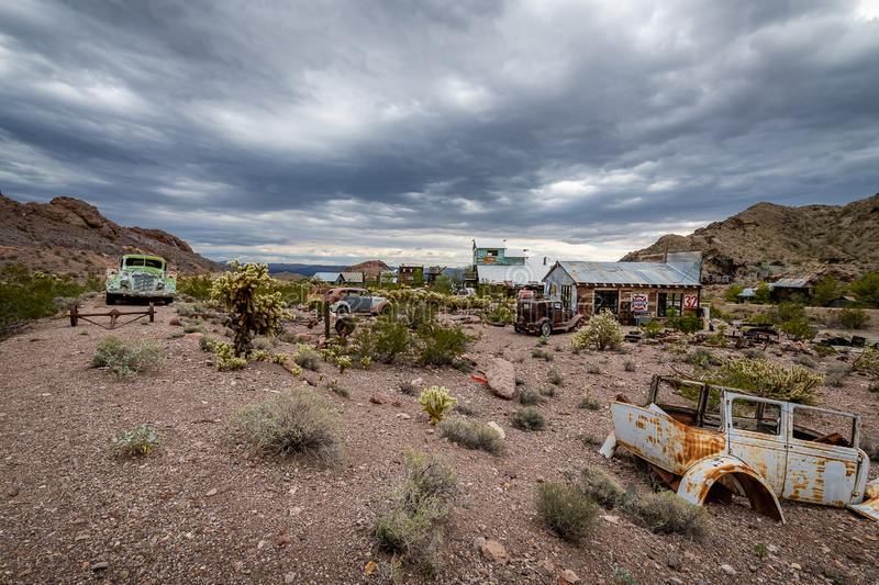 Storm clouds over the ghost town of Nelson. A rainstorm passes over the Nelson Ghost Town, which is famous as being a former silver mine. Today it is a tourist royalty free stock photo