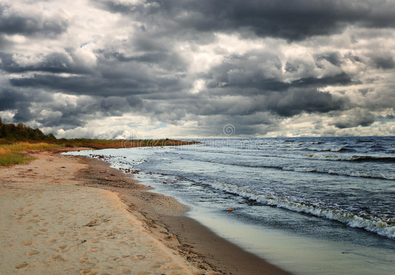 Rainy clouds over the lake royalty free stock image