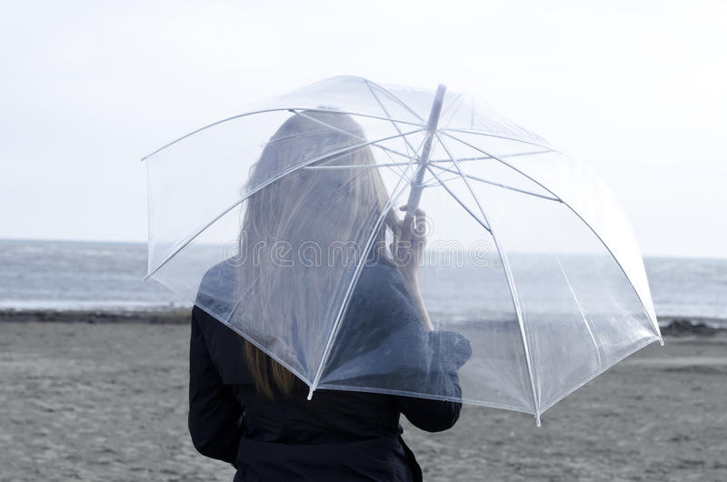 Download Rainy day on the beach stock photo. Image of smile, close - 26077686